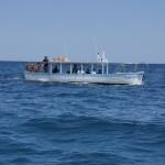 El vaixell, de pesca amb els companys de feina